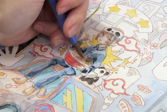 くすきなさんの透明水彩メイキング。男の子のまわりに散りばめられたモチーフを彩色していきます。
